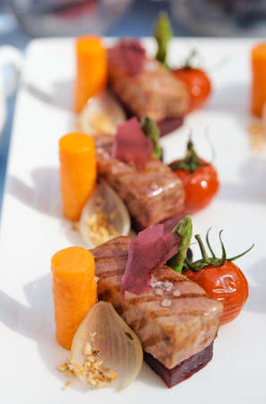 Modern cuisine dish with meat and vegetables photo