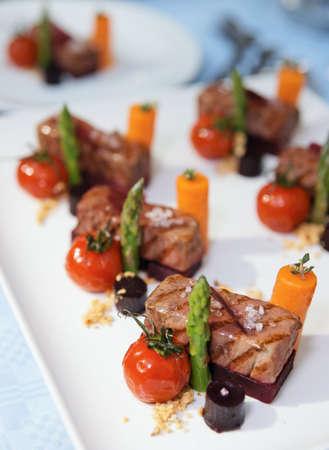 Modern cuisine dish on restaurant table photo