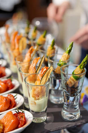 catering food: Glasses with seafood snacks -  banquet dish Stock Photo