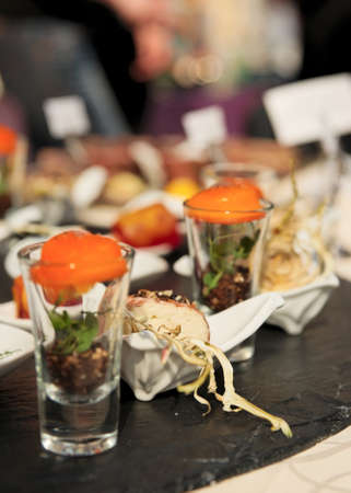 Various snacks in glasses on banquet table  photo