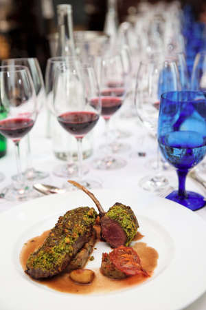 italian cusine: Grilled rack of lamb with mint and pistachio