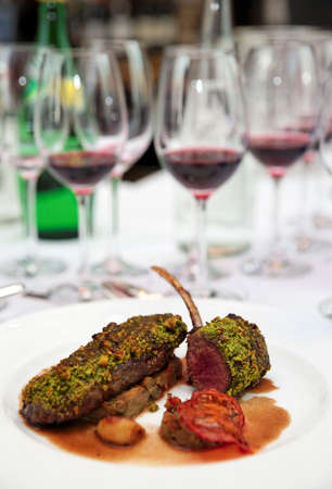 italian cusine: Grilled rack of lamb with mint and pistachio on arranged table