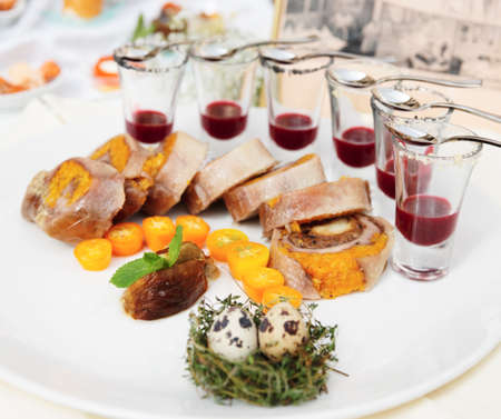 Meat rolls with sauce and quail eggs photo