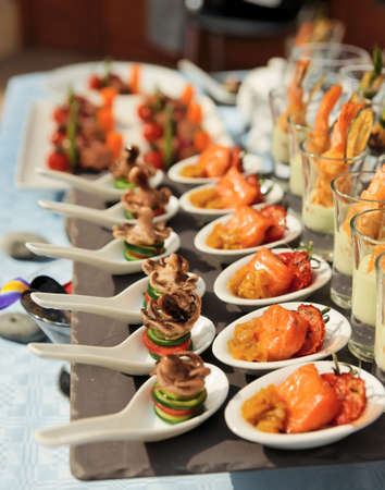 Spoons with seafood snacks -  banquet dish Stock Photo - 13965681
