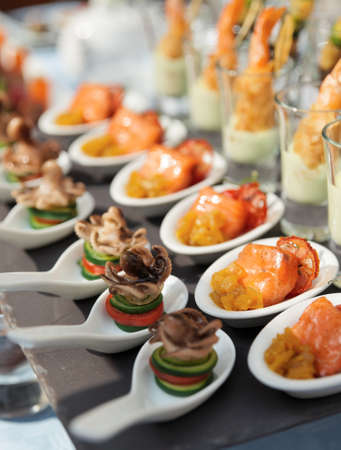 Spoons with seafood snacks -  banquet dish photo