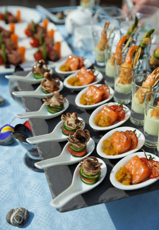 catering service: Spoons with seafood snacks -  banquet dish Stock Photo