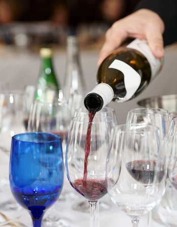 winetasting: Pouring wine during a winetasting event