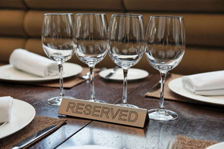 Reserved plate on an arranged restaurant table Stock Photo - 13965618