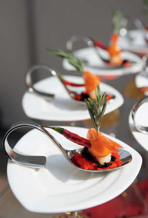 Sun-lit seafood snacks on banquet table photo