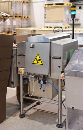 X-ray quality control device on food processing plant photo