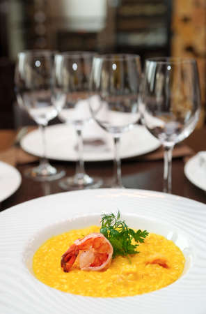 Risotto with shimp on arranged restaurant table photo
