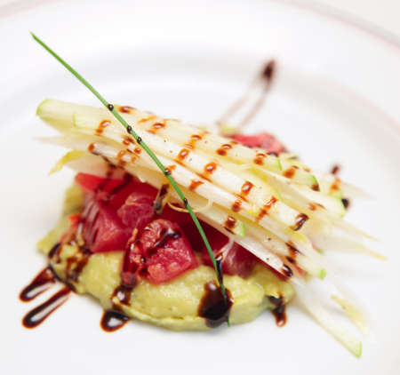 Tuna carpaccio with potato mash in plate photo