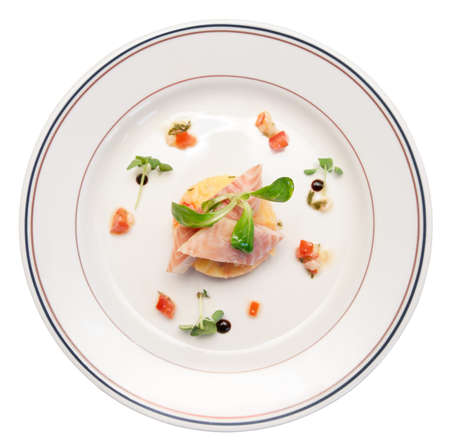 Smoked eel dish on porcelain plate, isolated  photo