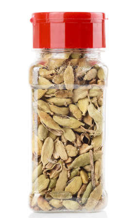 cardamum: Cardamom in plastic container isolated on white background Stock Photo