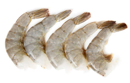 peeled: Raw prawns isolated on white background