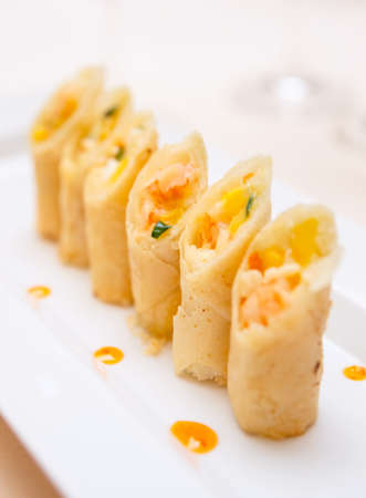 fine fish: Spring rolls with shrimps on plate, close-up