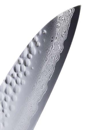 cutting edge: Japanese gyuto knife cutting edge of damascus steel,  close-up, isolated