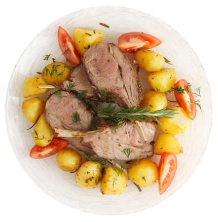 Rustic style rack of lamb with fried potatoes isolated on white photo