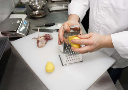 metal grate: Chef is cooking potatoes, commercial kitchen