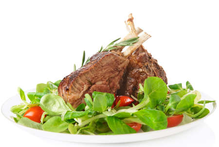 Rare fried rack of lamb isolated on white background photo