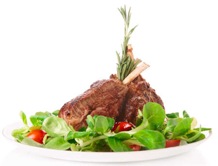 rack of lamb: Rare fried rack of lamb isolated on white background