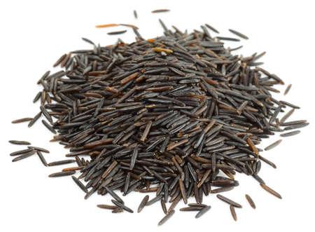 wild rice: Wild black rice heap isolated on white background Stock Photo