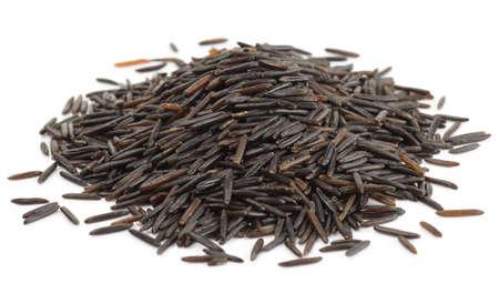 wild rice: Heap of wild black rice isolated on white background