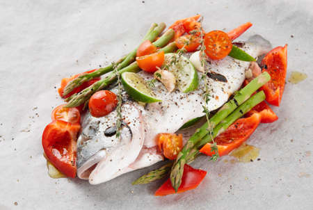 dorade: Dorade with herbs and vegetables prepared for roasting