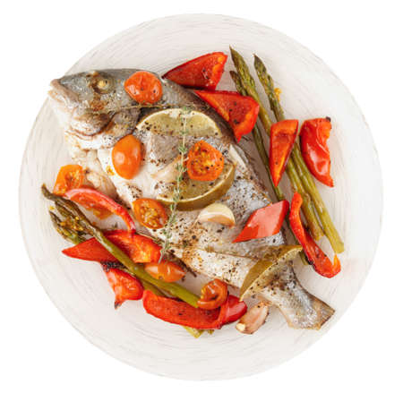 gilthead bream: Roasted gilt-head bream with vegetables on plate, isolated on white background