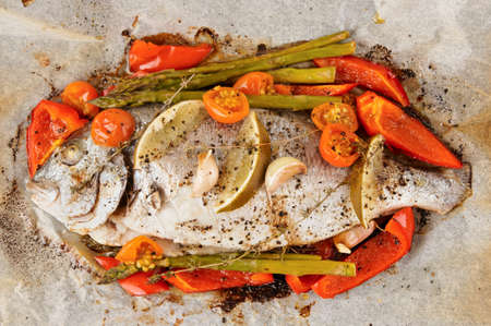Dorade with vegetables roasted in culinary paper shot from above Stock Photo - 18028332