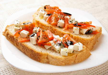 Homemade bread with feta cheese, balsamic vinegar and aromatic herbs and olive oil photo