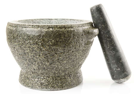 Granite mortar used for making sauces, isolated on white background photo
