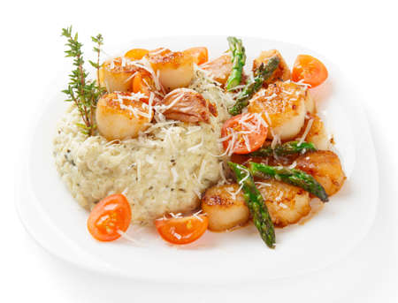seared: Risotto with pan seared sea scallops isolated on white background