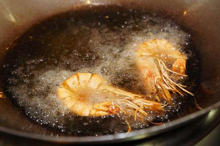 friture: Prawns being fried in wok pan Stock Photo
