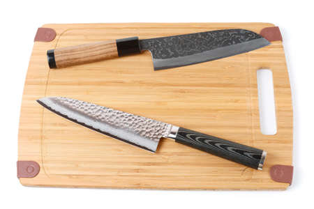 grinded: Two top grade japanese knives on bamboo cutting board, isolated