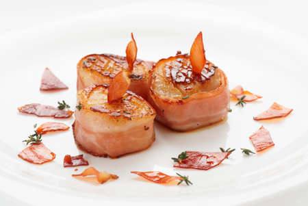 Scallops wrapped in bacon and pan seared