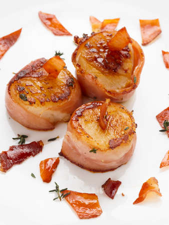 scallop: Scallops wrapped in bacon and seared, close-up