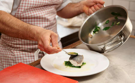 seabass: Chef is serving steamed seabass with spinach