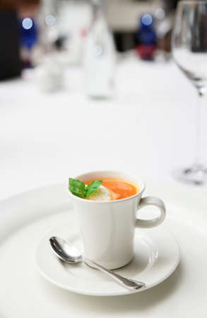 gaspacho: Gaspacho soup served in coffee cup on plate, copy space