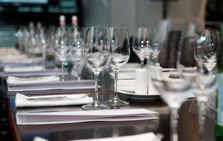 business dinner: Table set for official dinner, focus on glasses
