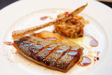 cooked fish: Seabass cooked in asian style with teriyaki sauce