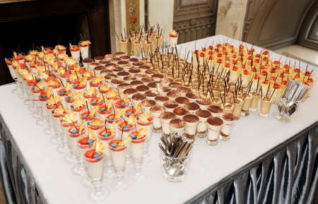quantity: Table with great quantity of desserts - catering event Stock Photo