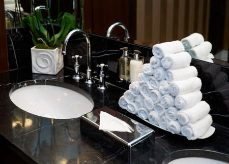 Restroom in hotel or restaurant, focus on towels photo