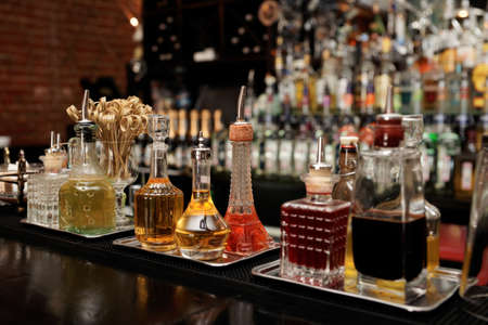 bar tool: Bitters and various infusions on bar counter Stock Photo