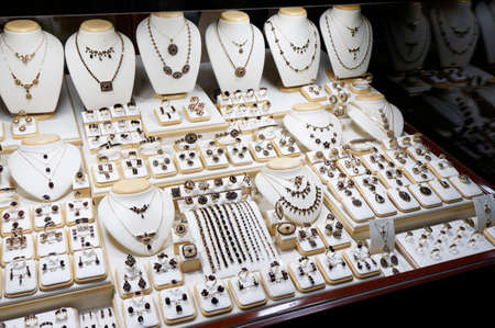 costume jewelry: Window display of a garnet jewelry shop                       Stock Photo