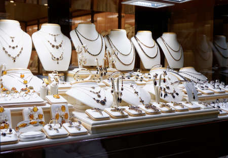 costume jewellery: Garnet jewelry shop window display Stock Photo