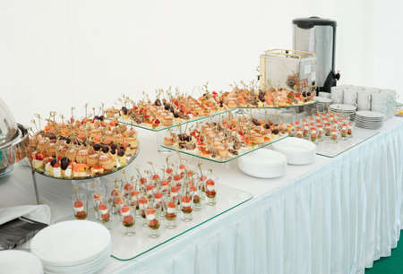Various meat, fish and cheese banquet snacks on banquet table, catering event photo