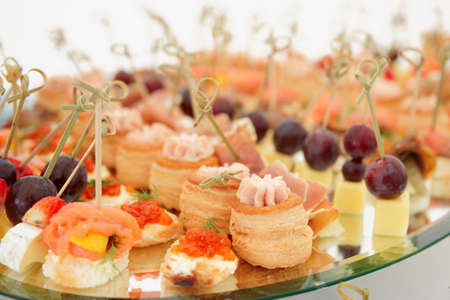 Meat, fish and cheese banquet snacks on banquet platter photo