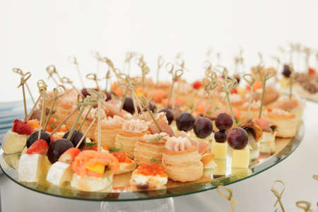 Small snacks in plate on banquet table photo