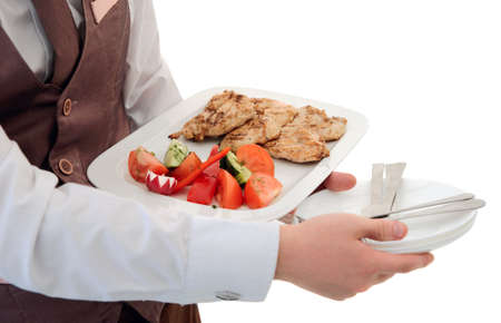 veggie tray: Waiter is offering grilled meat and vegetables, isolated on white Stock Photo
